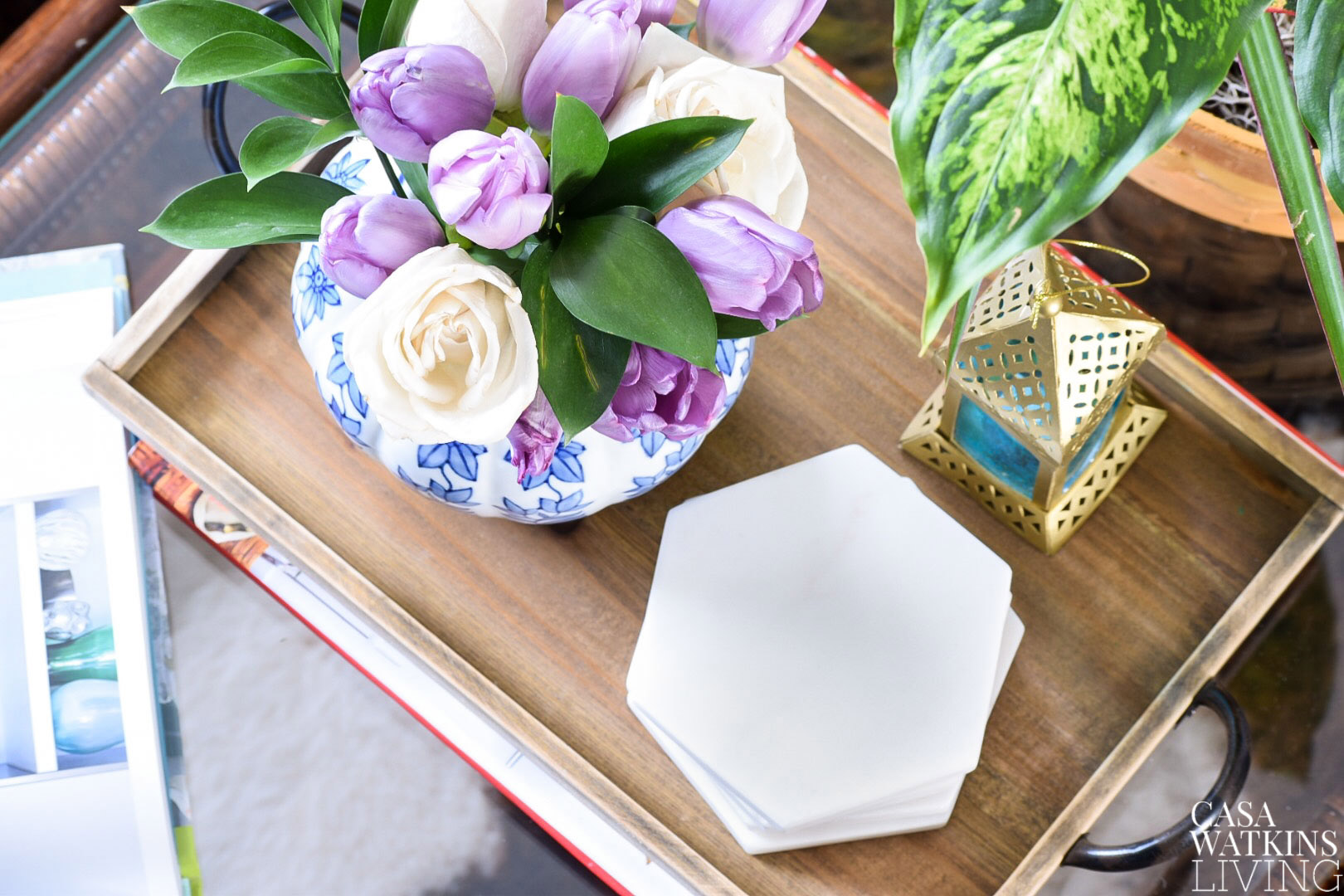 purple tulips and roses are 15 days old and still looking great on this wooden tray vignette