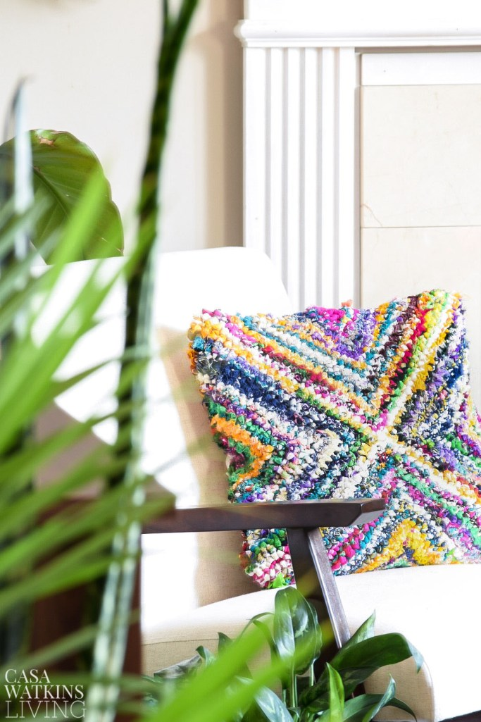 colorful boho style pillow in tropical global style living room