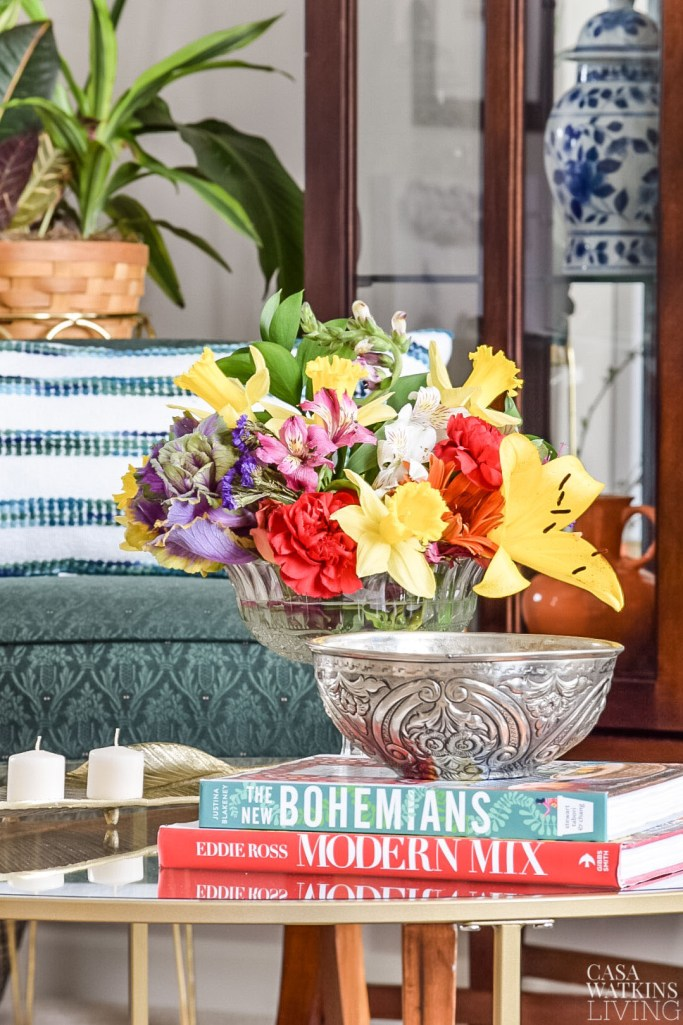 global boho style coffee table decor with hammam bowl, flowers, and candles