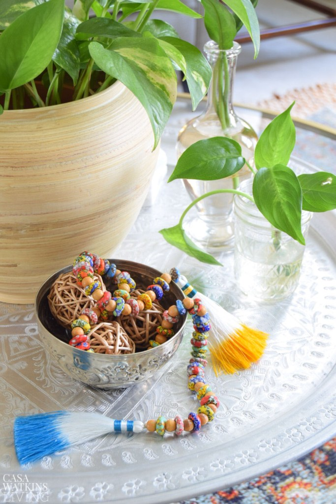 use African beads to make a global style version of a wood bead garland