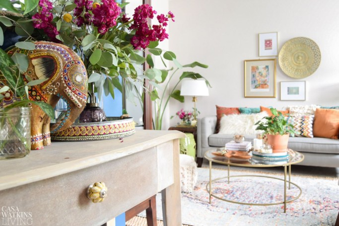 boho eclectic entryway decor with unfinished table