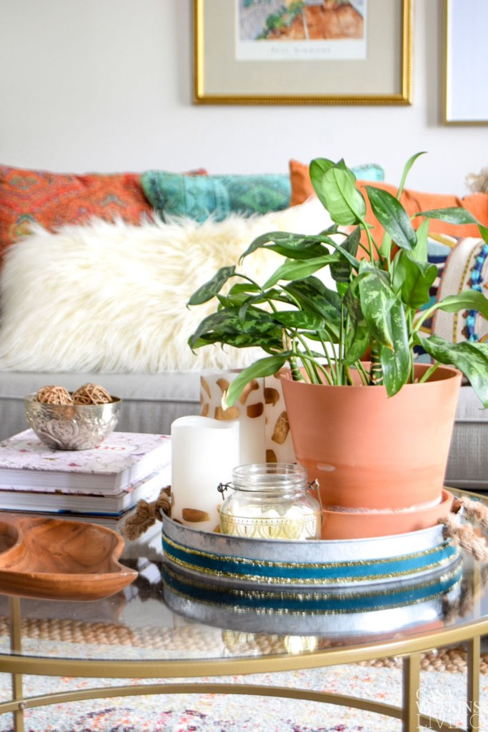 fall coffee table decor with plants, tray, and metallic lantern