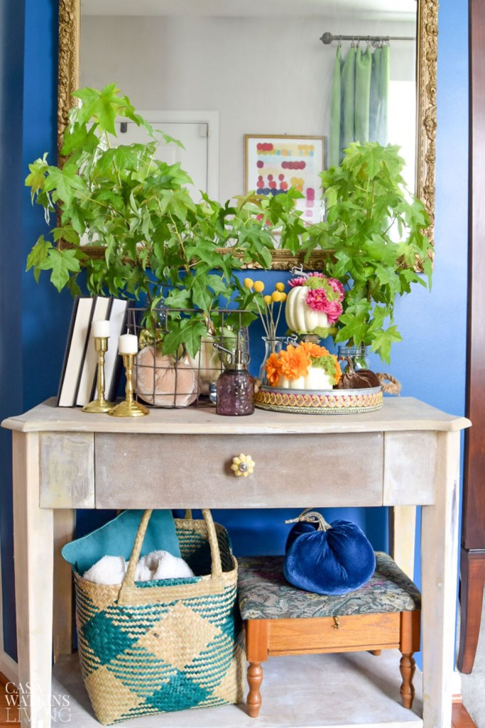 global style fall entryway decorating with pumpkins