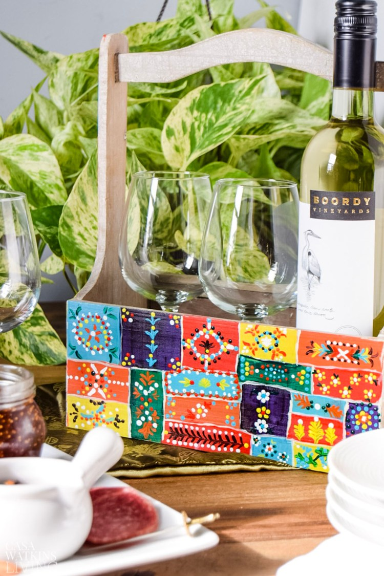 Indian inspired diy painted wine caddy.  Great DIY hostess gift!