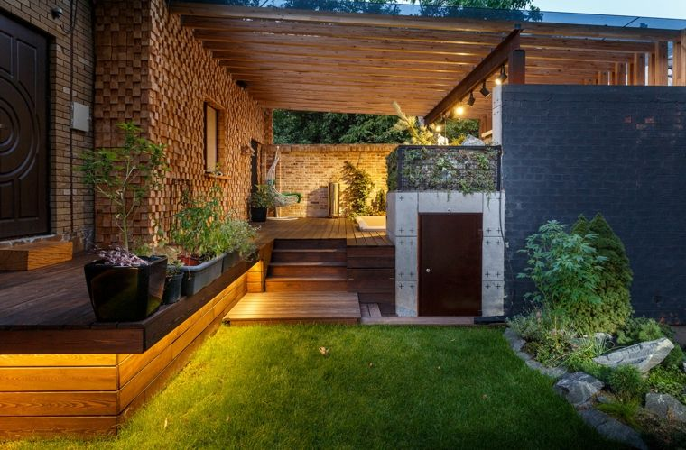 Sala de estar al aire libre diseada por Svoya Studio