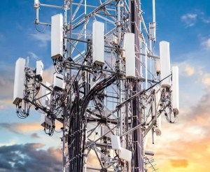 5G Sunset Cell Tower: Cellular communications tower for mobile phone and video data transmission