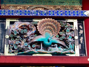 Close-up of some of the ornate decorations that cover the structures throughout Tōshō-gū Shrine. Each are being restored by hand, including paint and gold leafing.