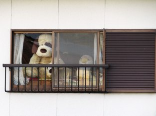 These guys were peering out the window of an apartment. After our fifth brewery, it was a pretty hilarious sight.