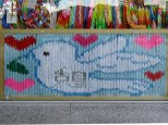 A dove created with hundreds of folded paper cranes