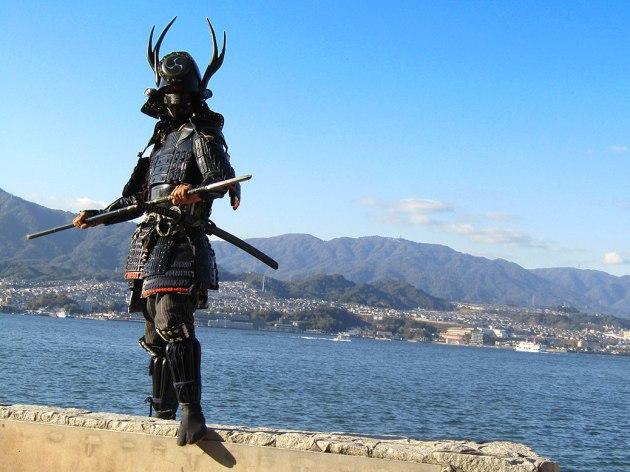 """Samurai"" in full costume offered kids a chance to dress up and take photos with them along the Miyajima bayfront path"