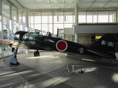 """A Japanese """"Zero"""" fighter plane, similar to the ones used in the 1941 attack on Pearl Harbor, is displayed in the lobby of the Yūshūkan military museum"""
