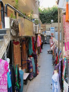 Peering down an alley with tourist shops.