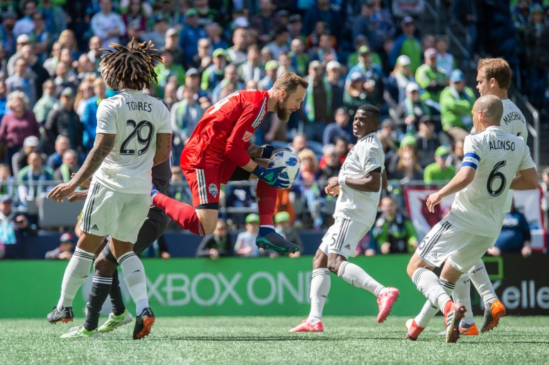 Stefan Frei charges the ball