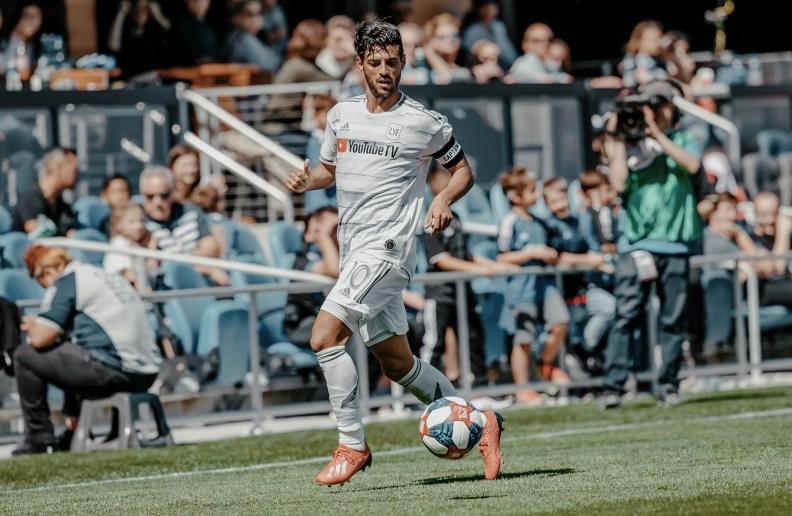 Carlos Vela dribbles ball