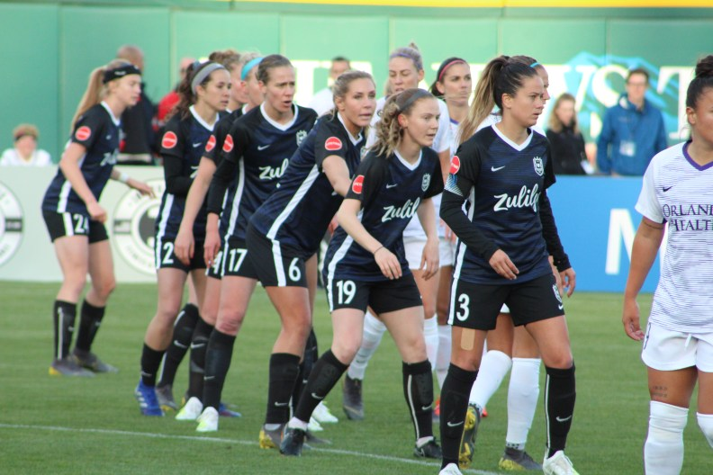 Reign  players get set to defend