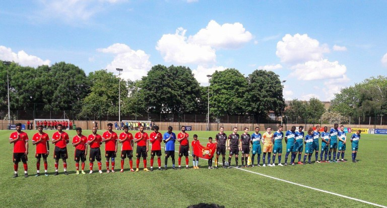 The Tamil and Cascadian teams stand for the playing of each team's anthem before their match.