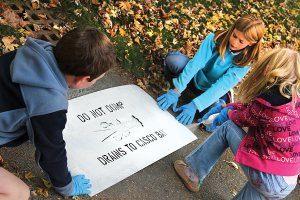 Kids Storm Drain Stenciling