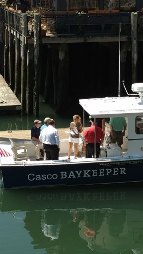 Casco Baykeeper Ivy Frignoca and Portland Water District Staff on Baykeeper Boat