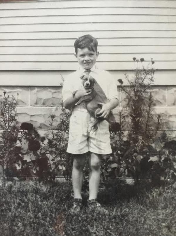 Dad as boy with puppy