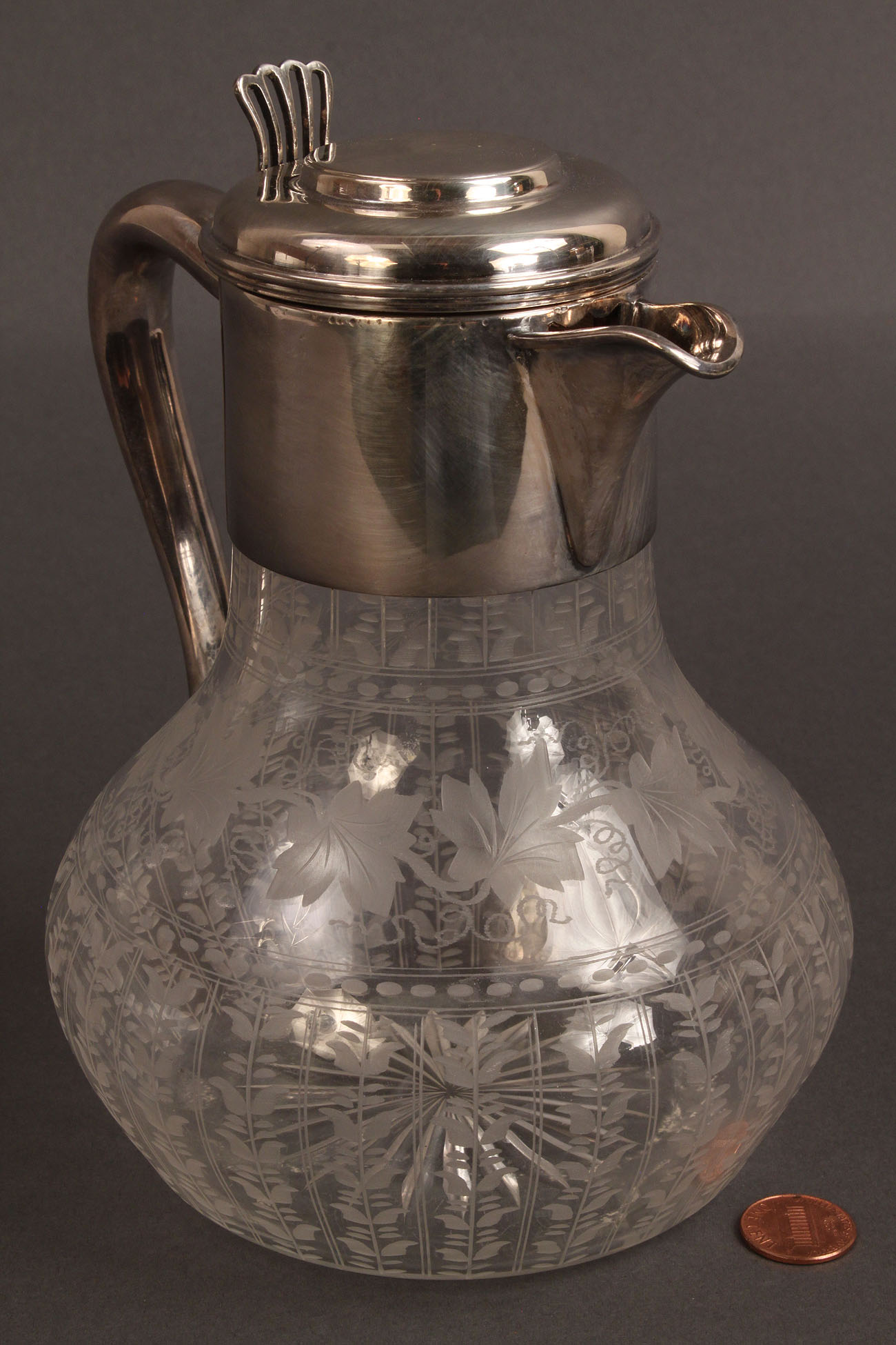 Lot 366 Engraved glass vase and pitcher Hawkes