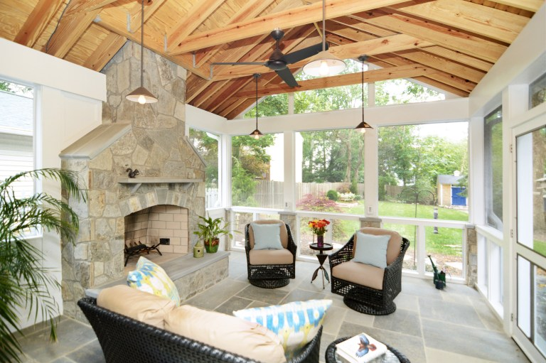 screened-in porch addition natural wood ceiling flagstone floor fireplace with ceiling fan