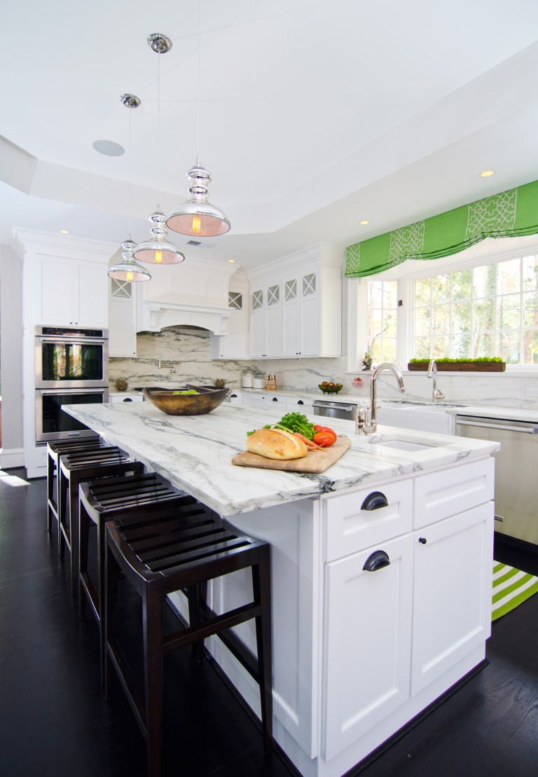 bright white kitchen with center island and bar seating