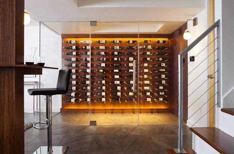 modern renovated basement with glass wall wine cellar