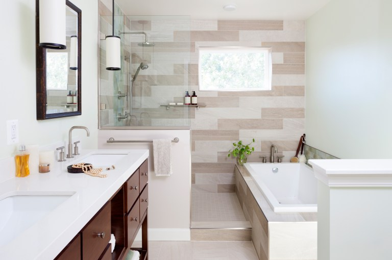 modern bathroom separate tub wood vanity natural color palette rain waterfall shower head