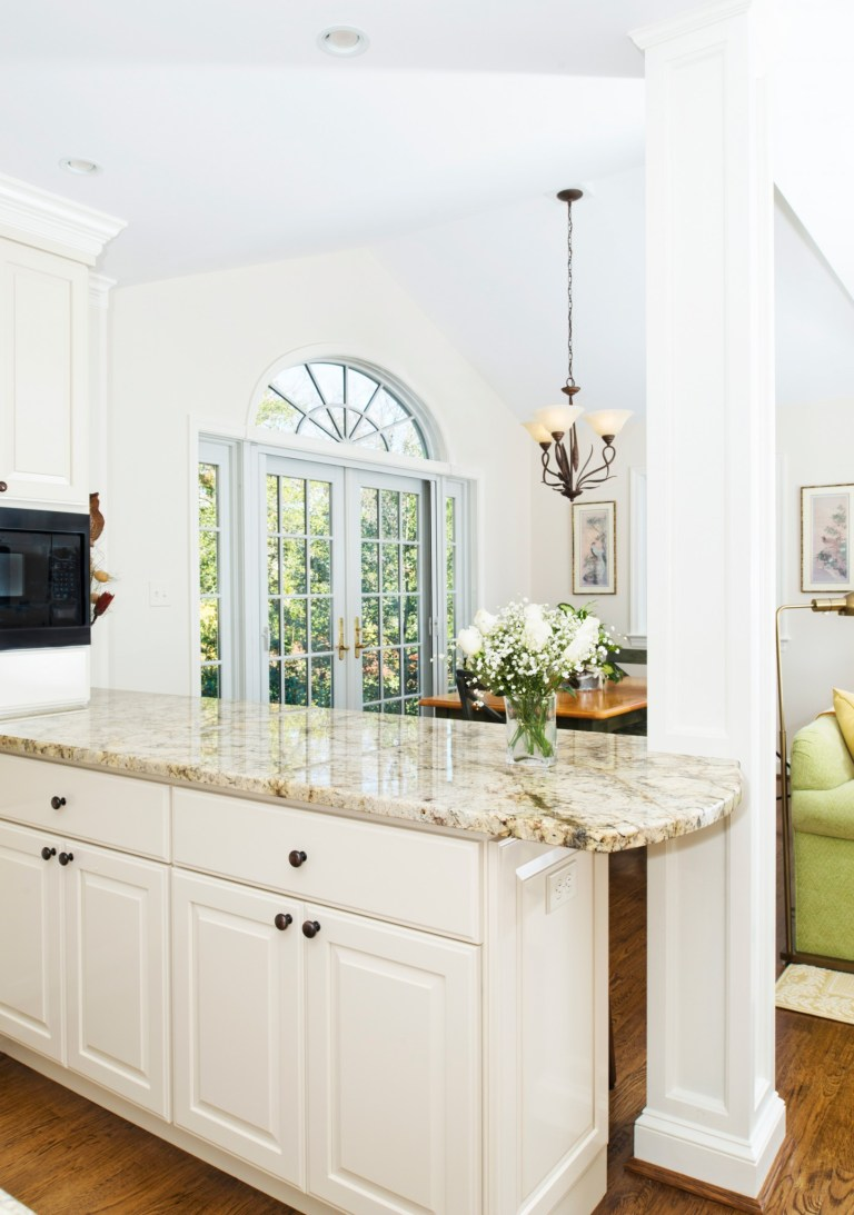 bright kitchen white cabinet peninsula with granite counter tops french doors