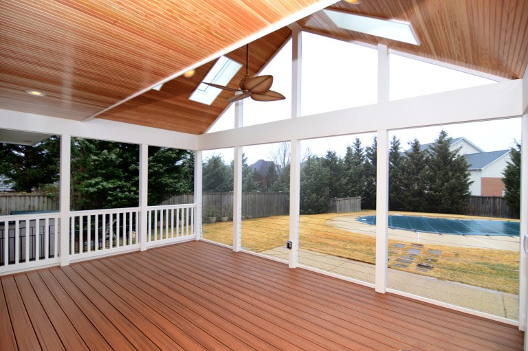 large screened in porch addition with vaulted wood ceiling and skylights
