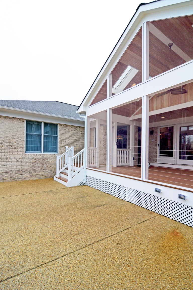 screened in porch addition with stairs out to yard