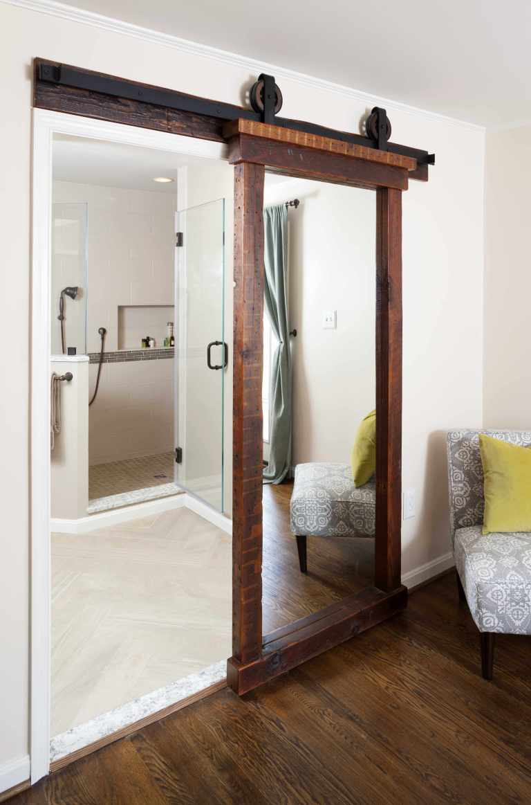 sliding frosted glass barn door in master bathroom
