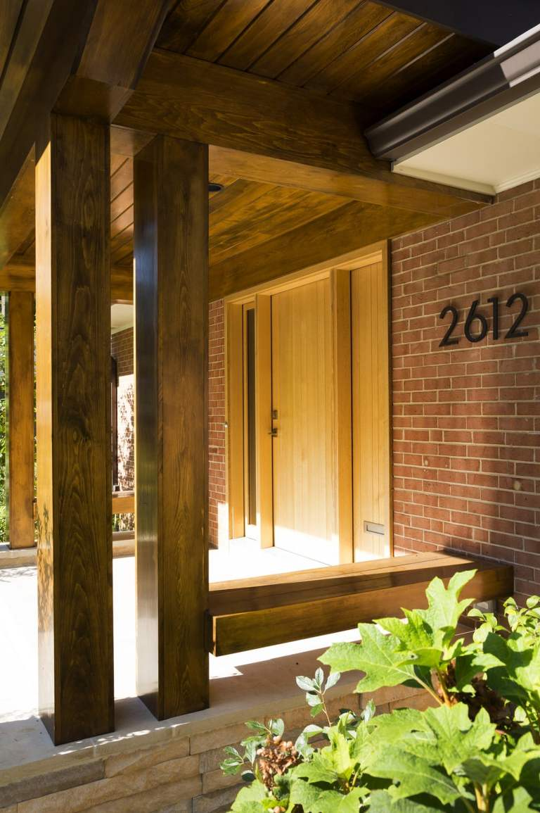 modern brick home new front porch with wood columns and overhang mixed materials