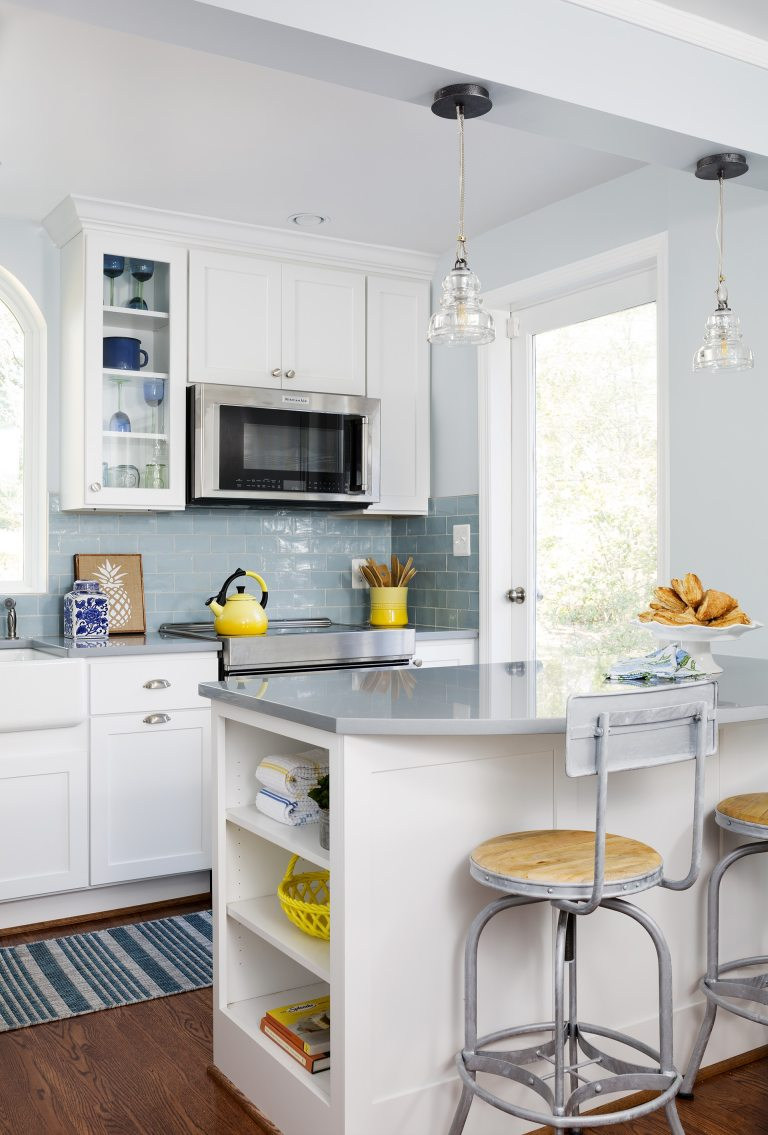 peninsula with seating and open shelving storage built in pendant lighting