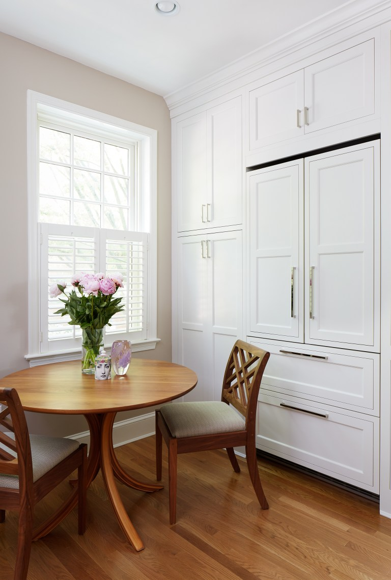 kitchen eat in area and paneled refrigerator