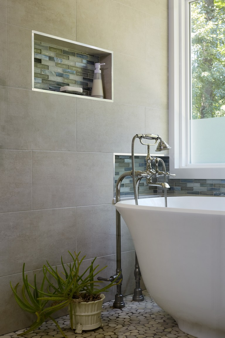 freestanding bathtub with accessible storage nooks accent tiles in nook stainless steel trim natural color palette