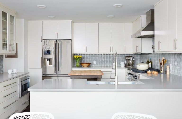 bright kitchen with stainless steel appliances and peninsula with seating