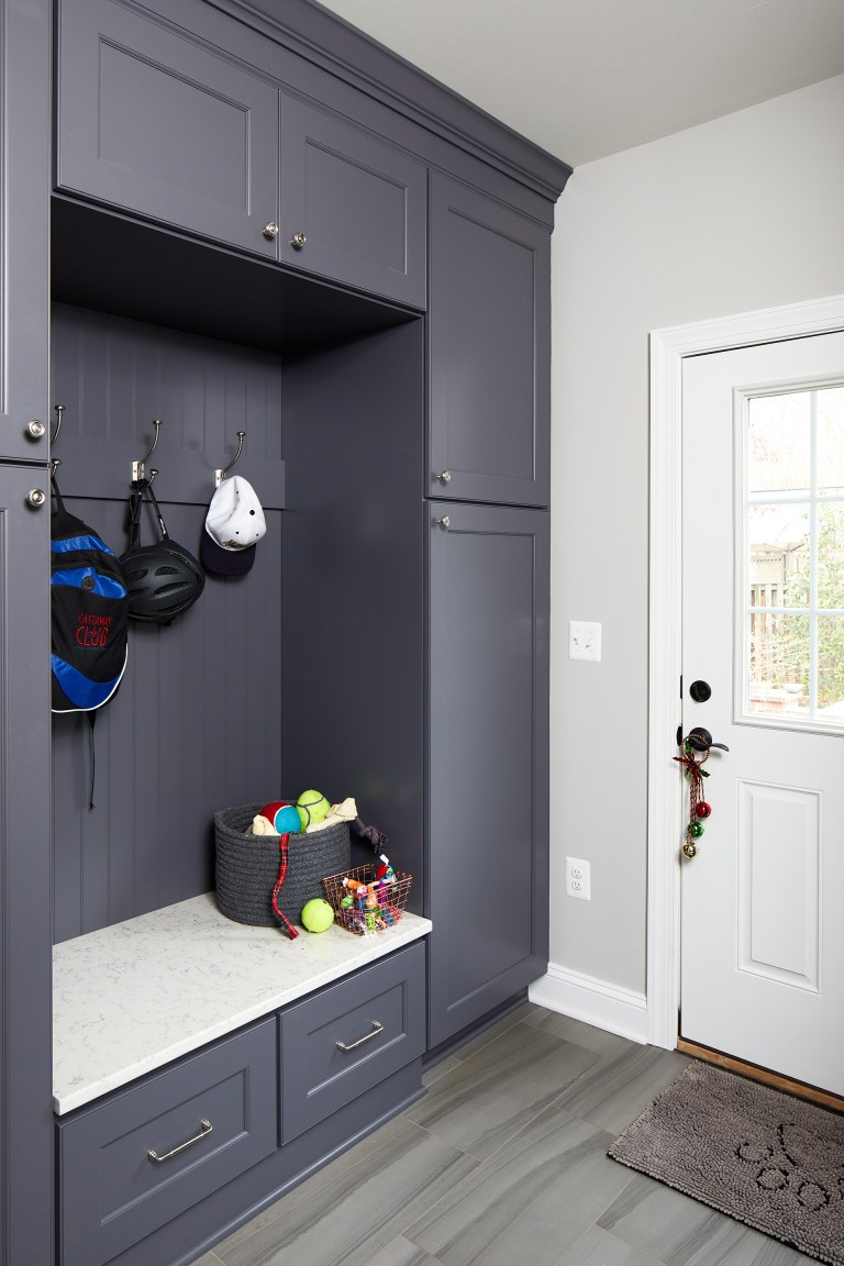 mudroom renovation gray floors grayish blue cabinetry storage and hooks