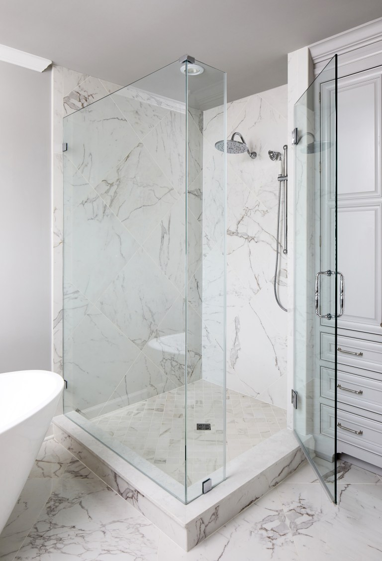 single walk in shower with pull tall glass doors keeps water and steam contained, stainless steel 1-handle shower
