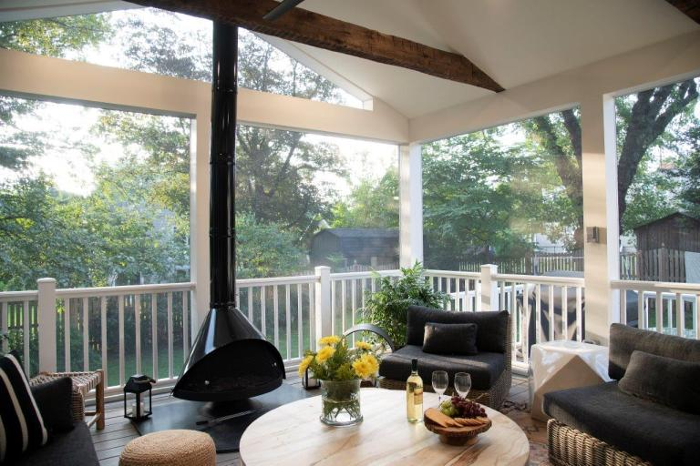 patio ideas with large screen porch with wood beam ceiling, all weather furniture and fabric outfit the screen porch