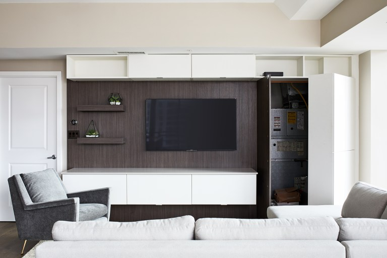 case design living room with white hidden storage with three shelves