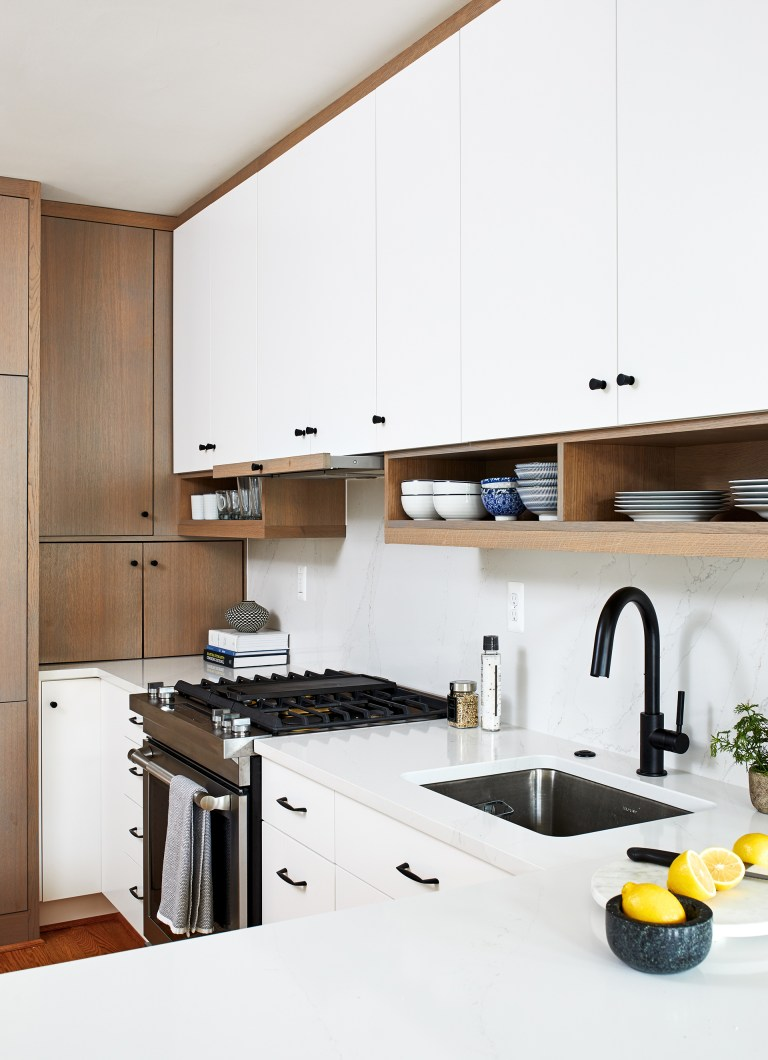 thin sleek pull-out range hood, white and brown cabinets with hanging shelves
