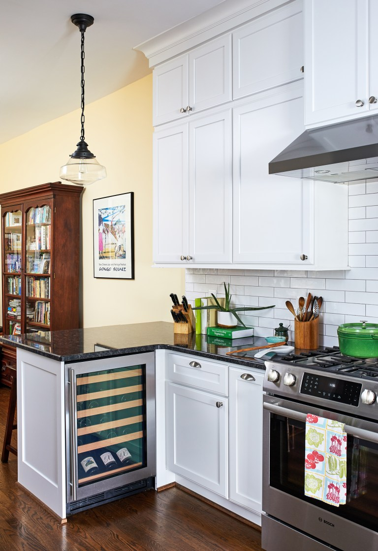 hanging light above black counter with small wine chiller cabinet mini fridge