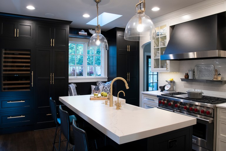 transitional kitchen island with sitting and hanging light fixtures
