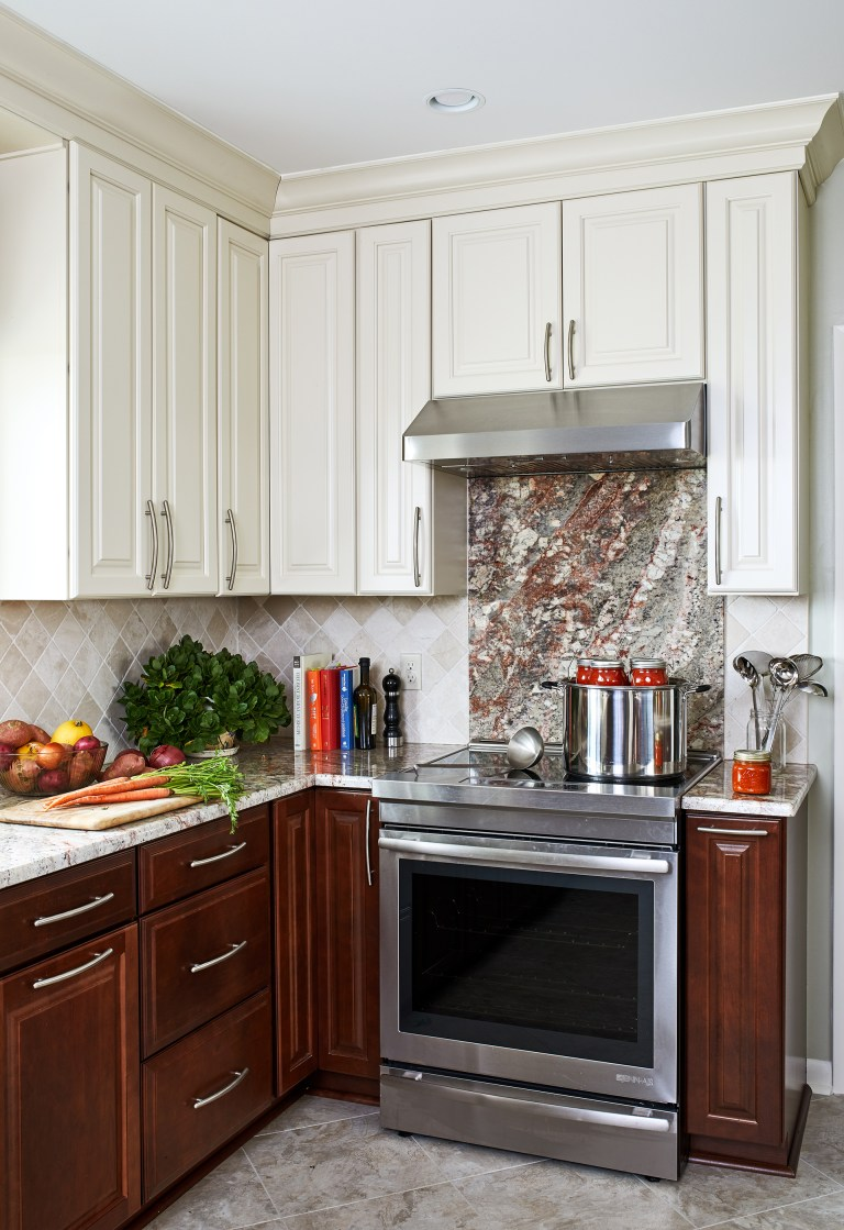 Traditional kitchen backsplash with stainless steel stove and hood range