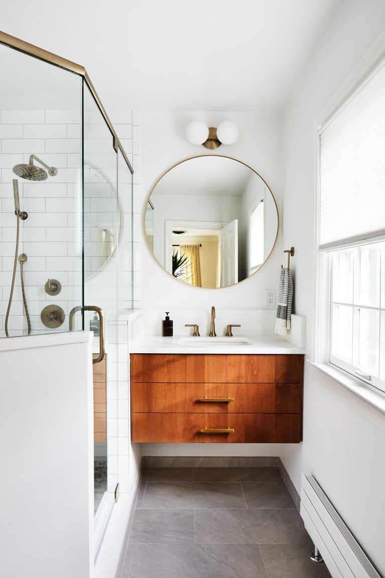 modern bathroom in white with small wooden vanity