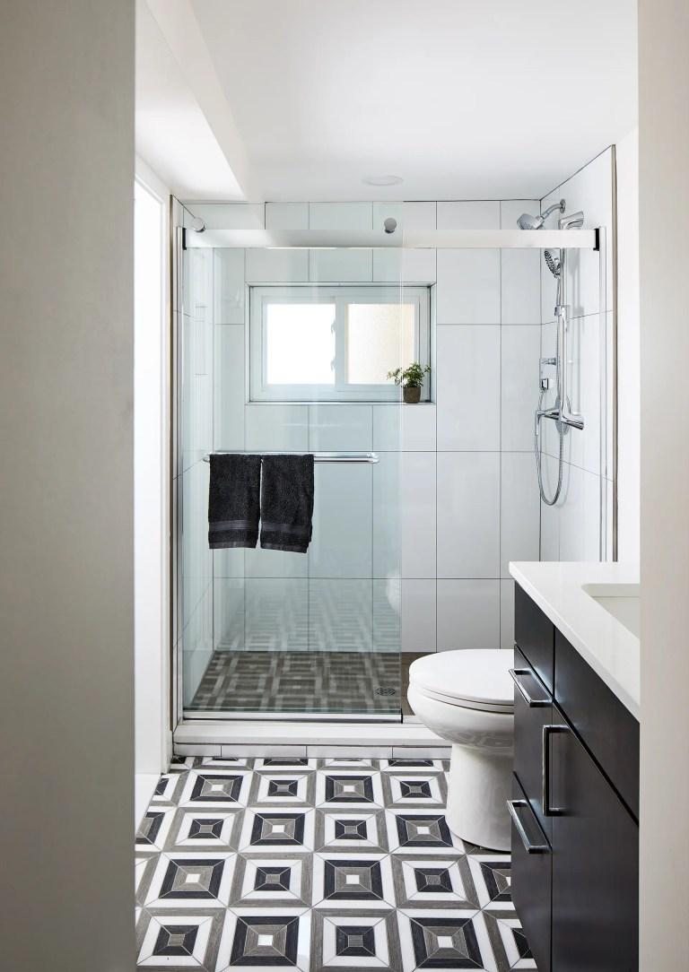 case design build bathroom with bypass glass sliding shower door in chrome
