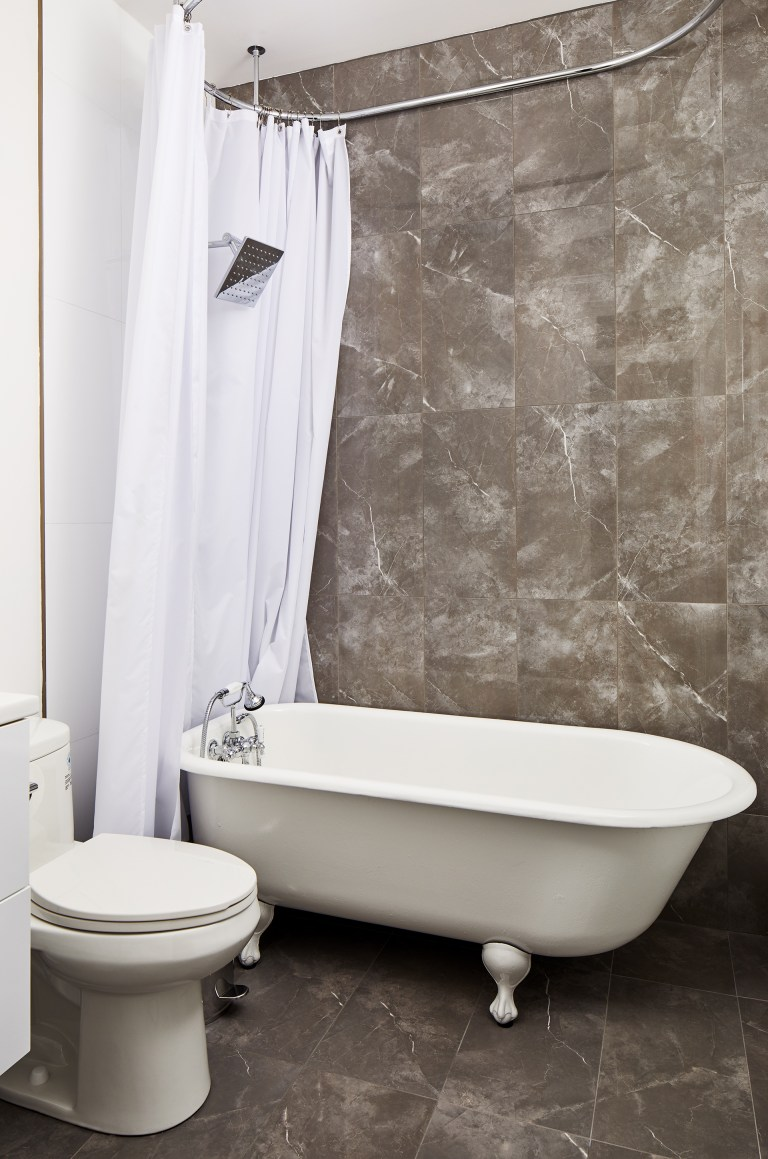 case design bathroom rim mount soaking tub in white with shower faucet in starlight chrome