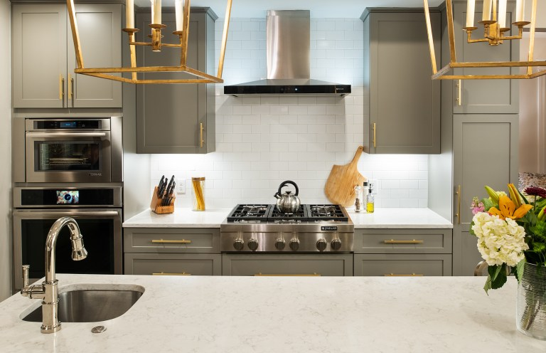 case design kitchen with brushed gold light fixtures