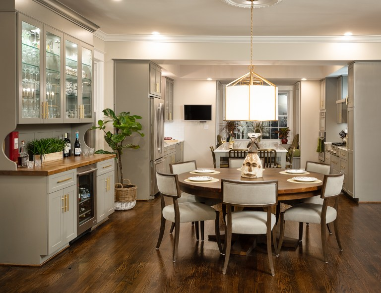 case design transitional kitchen with round wood dining table stainless steel appliance